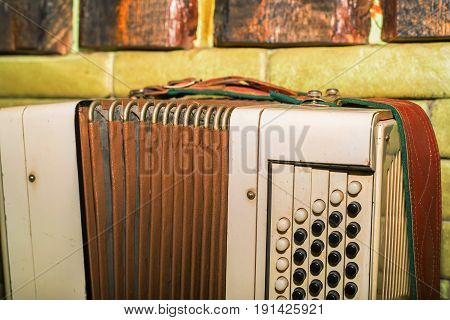 Close-up of old Russian traditional musical instrument bayan