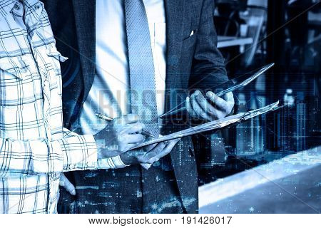 double exposure Professional businessman hold digital tablet and signing deal of new project
