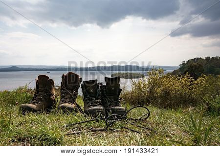 Hiking boots in front of beautiful lake