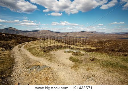 Scottish hiking path in front of beautiful landscape