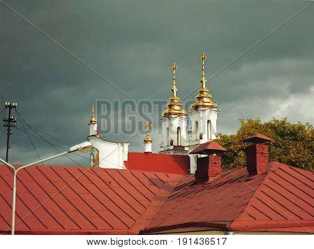 Domes of the Resurrection church and a roof against autumn sky, Vitebsk, Belarus - september 2016