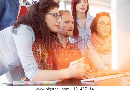 Business people working together on computer in office
