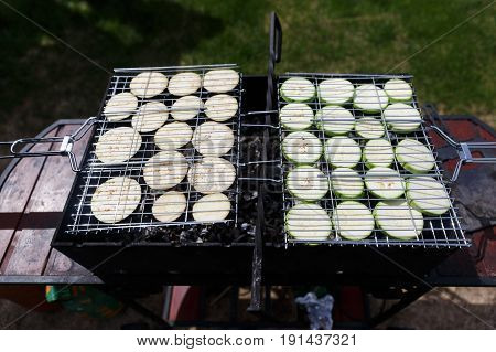 Photo of courgettes and aubergines on barbecue grill in summer
