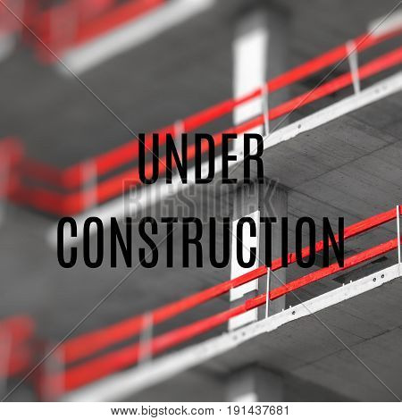 Word Under Construction. Industrial Building Construction With Steel Structure And Concrete.