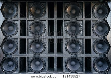 Speakers collage useful image in a musical composition. Wall of large black music speakers.