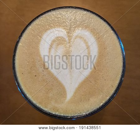 white heart foam art in morning latte
