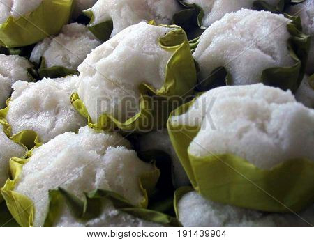Puto or steamed rice cake Puto is a popular delicacy in the Philippines, made from ground rice, milk, sugar and other ingredients and wrapped in banana leaves.