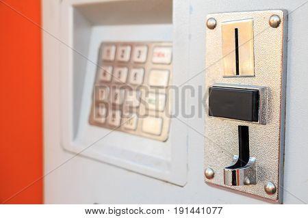 Closeup image of modern parking meter with keyboard
