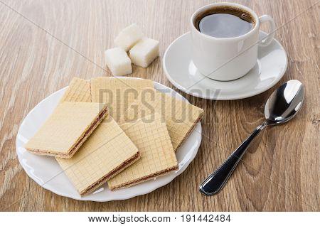 Heap Of Waffles In White Plate, Lumpy Sugar, Black Coffee