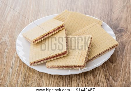 Heap Of Waffles In White Plate On Table