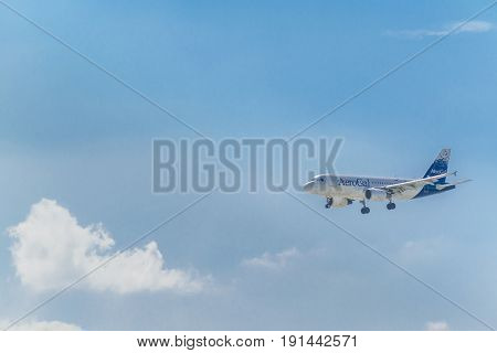 Plane Landing At City Airport
