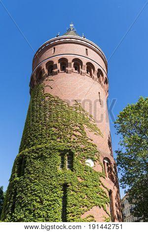 Old Water Tower Overgrown With Ivy In Berlin Kreuzberg