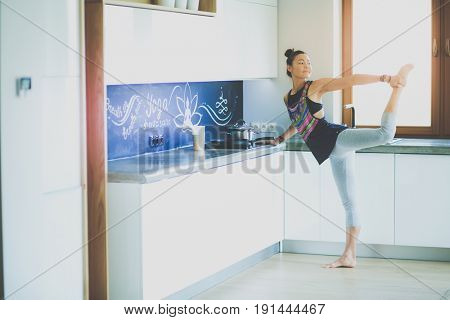 Fitness girl cooking healthy food in the kitchen. Woman. Kitchen