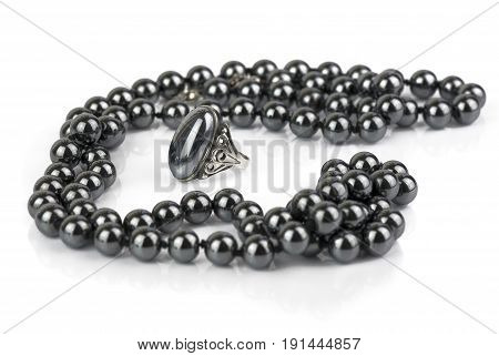 glossy black beads and a ring made of natural hematite