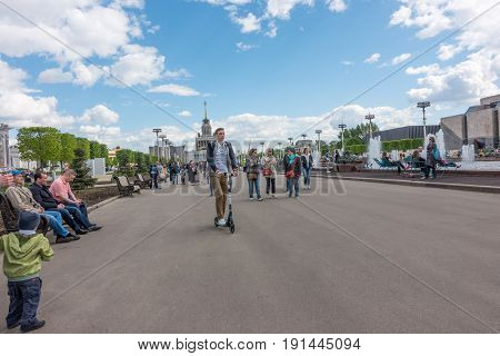Moscow, Russia - May 27, 2017: people walking in the park of VDNKh - Exhibition of Achievements of National Economy.
