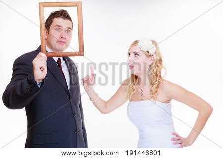 Angry Groom And Bride Holding Empty Frame