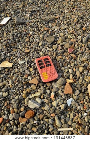 Abandoned broken wellknown nanufacturer and messenger service cellphone toy,