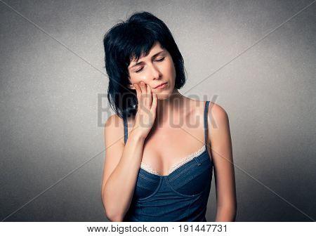 Woman close up has a teeth pain