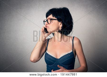 Funny woman close up using mobile phone