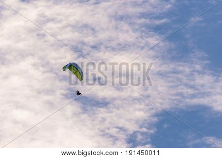 The Paraglider With A Green Wing And Motor On Back