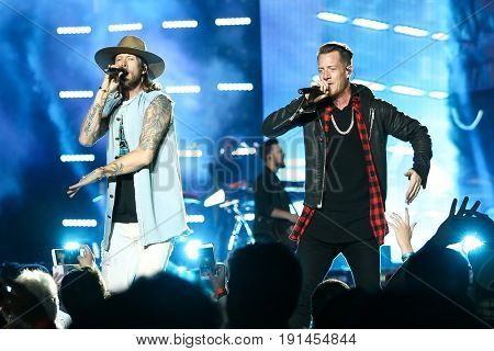 WANTAGH, NY-JUN 15: Brian Kelley (L) and Tyler Hubbard of Florida Georgia Line perform in concert at Northwell Health at Jones Beach Theater on June 15, 2017 in Wantagh, New York.