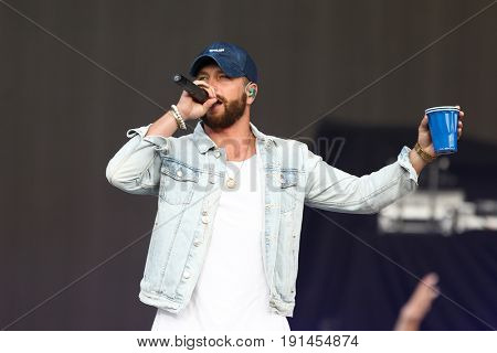 WANTAGH, NY-JUN 15: Chris Lane performs in concert at Northwell Health at Jones Beach Theater on June 15, 2017 in Wantagh, New York.