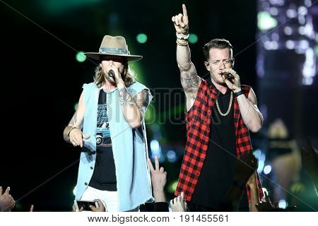 WANTAGH, NY-JUN 15: Brian Kelley and Tyler Hubbard of Florida Georgia Line perform in concert at Northwell Health at Jones Beach Theater on June 15, 2017 in Wantagh, New York.