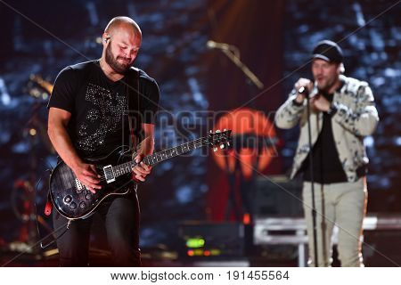 AUSTIN, TX - APRIL 30: Sam Hunt (R) performs during the 2016 iHeartCountry Festival at The Frank Erwin Center on April 30, 2016 in Austin, Texas.