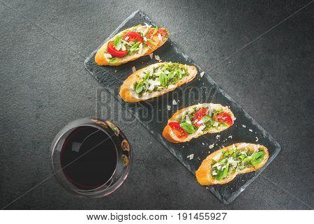 Bruschetta With Pesto, Parmesan, Tomatoes And Basil