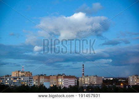 Clouds gather in the sky over the evening city