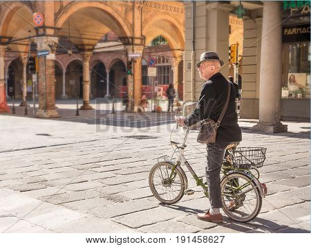 Bologna Italy - April 22 2017: Senior bicycle man in the center of bologna in a sunny day
