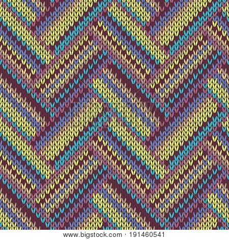 Seamless knitted pattern. Multicolored repeating tribal template.