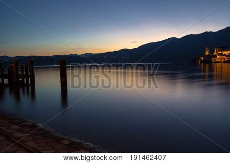 sunset over orta san giulio in italy