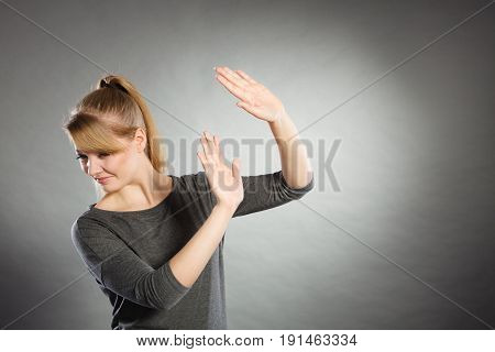 Refusal negative threat danger communication concept. Nervous lady protecting herself. Stressed girl making defensive gesture with arms gesturing stop with palms hands