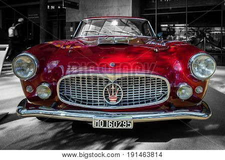 STUTTGART GERMANY - MARCH 02 2017: Grand tourer car Maserati 3500 GT (Tipo 101) 1958. Combined toning. A colored car on a black and white background. Europe's greatest classic car exhibition