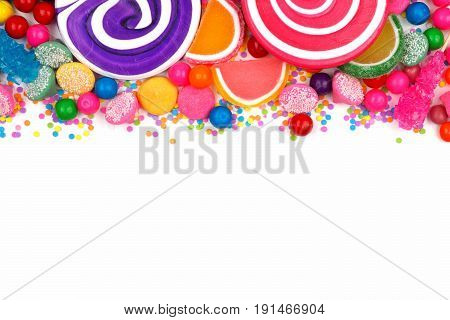Top Border Of An Assortment Of Colorful Candies Against A White Background