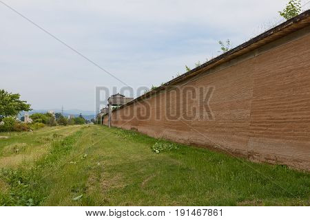 MORIOKA JAPAN - MAY 22 2017: Reconstructed clay wall (tsuijibei) and watchtowers of Shiwa Castle in Morioka Japan. Castle was erected in 803 against local emishi tribes and abandoned in 811