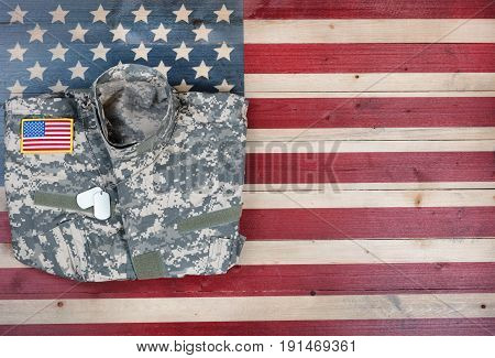 United States military uniform on rustic wooden flag in flat view layout
