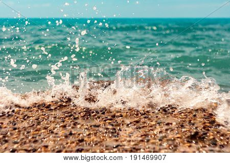 Blue sea waves with a lot of sea foam. Beautiful blue waves with a lot of sea foam scene looked from above, close up