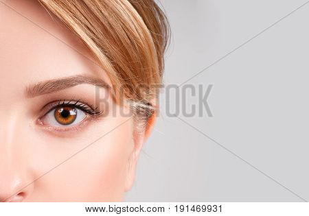 Beauty Concept. Beautiful Female Brown Eyes