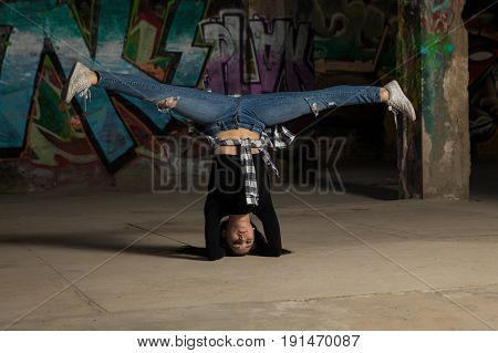 Dancer Doing A Headstand With Leg Split