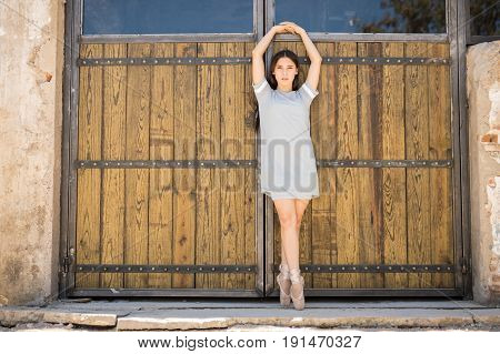 Young Ballerina Performing Outdoors