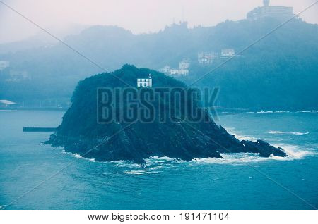 Small island by San Sebastian coast. Spain.