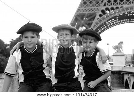 JULY 16, 2012. PARIS, FRANCE. CIRCA: Boys posing on vacation at the famous Eiffel Tower landmark in Paris, France.