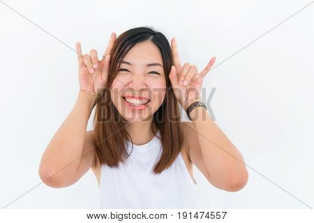 a joyful smiling asian girl with white undershirt is posing on the white background