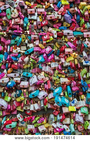 SEOUL SOUTH KOREA - NOV 03: Love locks on the Seoul N Tower the activity that couples will padlock on the grille on November 03 2016 in Seoul South Korea