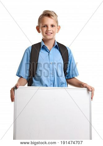Happy smiling male pupil with bag and whiteboard
