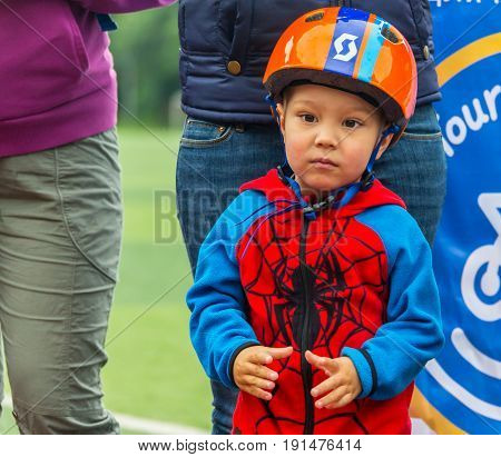 KAZAKHSTAN, ALMATY - JUNE 11, 2017: Children's cycling competitions Tour de kids. Children aged 2 to 7 years compete in the stadium and receive prizes. Children at the solemn construction - waiting for the start of the competition