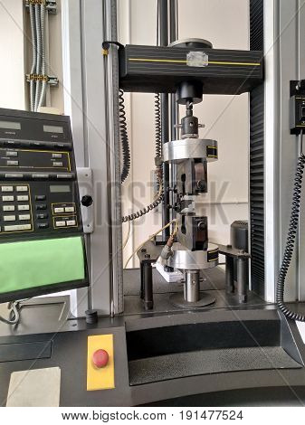 tensile strength test engineering material property of metal and rubber are testing in physics laboratory