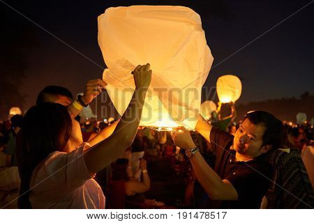 Mohnton, PA - June 10th, 2017: Group of people trying to lid up the lantern to set it fly high on Lantern Festival.